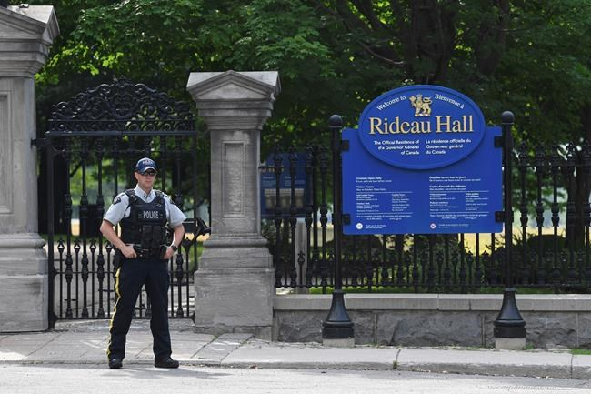 """A police officer stands by a fence outside Rideau Hall in Ottawa on Thursday. The RCMP say they have safely resolved an """"incident"""" at Rideau Hall, where Gov. Gen. Julie Payette and Prime Minister Justin Trudeau live.THE CANADIAN PRESS/Adrian Wyld"""
