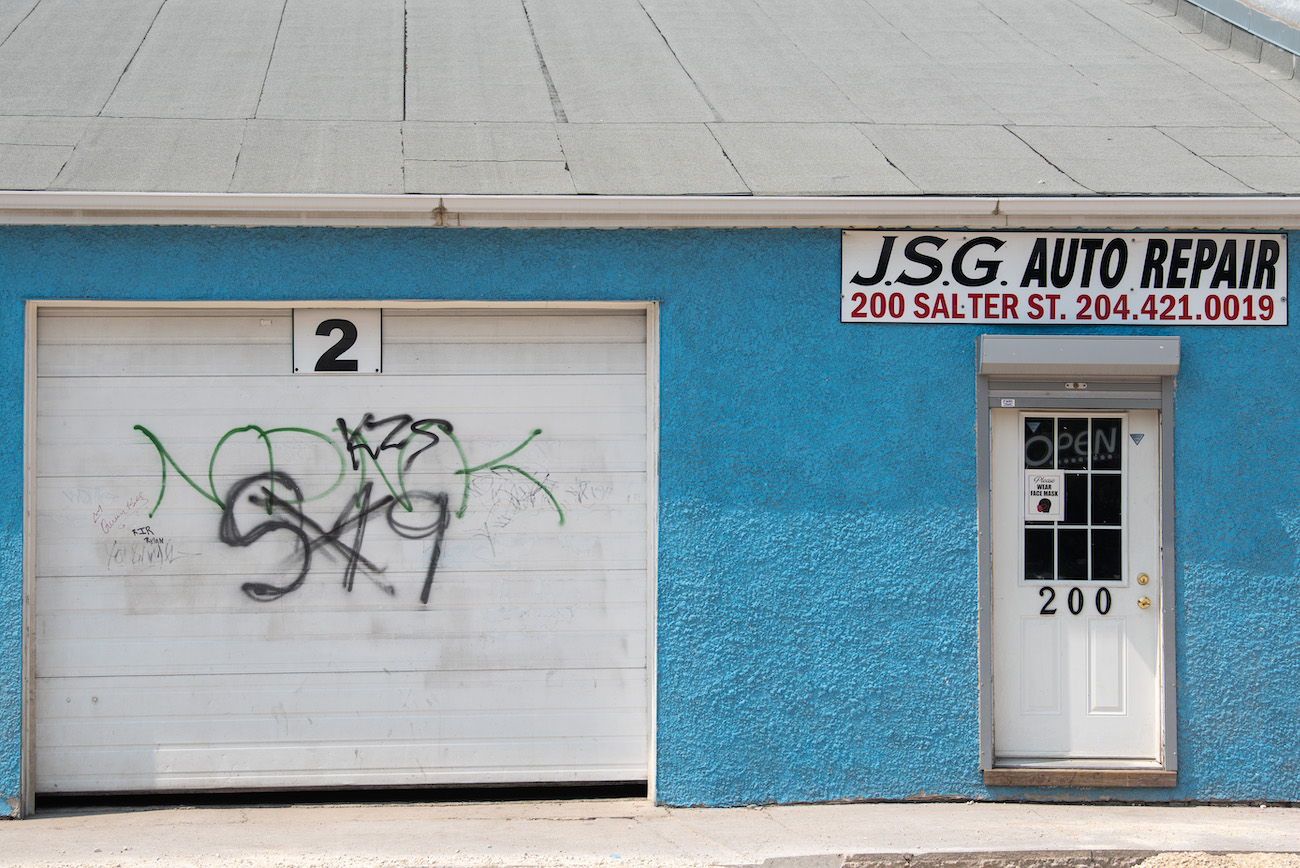 ALEX LUPUL / WINNIPEG FREE PRESS    JSG Auto Repair is photographed on Thursday, July, 29, 2021. The Salter Street shop was the scene of an assault, when a 35-year-old victim confronted a group of males spray-painting a gang insignia on the business.