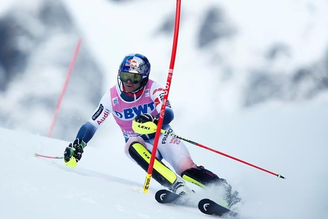 France's Alexis Pinturault competes during the first run of an alpine ski, men's World Cup slalom in Wengen, Switzerland, Sunday, Jan. 19, 2020. (AP Photo/Gabriele Facciotti)
