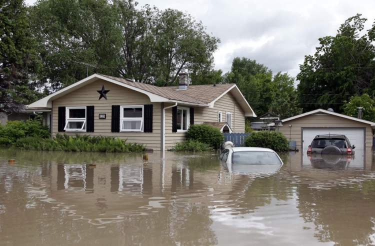 A flooded residence in High river, Alta. Heavy rains have caused flooding, closed roads, and forced evacuation in High River, Alta.,