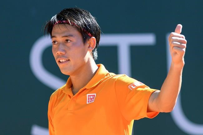 Japan's Kei Nishikori gestures after winning a game against South Africa's Kevin Anderson during the quarter final round match of the Geneva Open tennis tournament in Geneva Switzerland Thursday