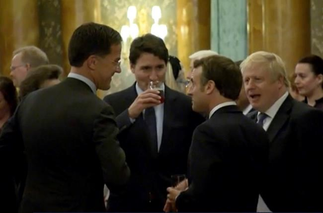 In this grab taken from video on Tuesday, Dec. 3, 2019, Britain's Prime Minister Boris Johnson, right, speaks during a NATO reception. While NATO leaders are professing unity as they gather for a summit near London, several seem to have been caught in an unguarded exchange on camera apparently gossiping about U.S. President Donald Trump's behavior. In footage recorded during a reception at Buckingham Palace on Tuesday, Canadian Prime Minister Justin Trudeau was seen standing in a huddle with French President Emmanuel Macron, British Prime Minister Boris Johnson, Dutch Prime Minister Mark Rutte and Britain's Princess Anne. (Host Broadcaster via AP)