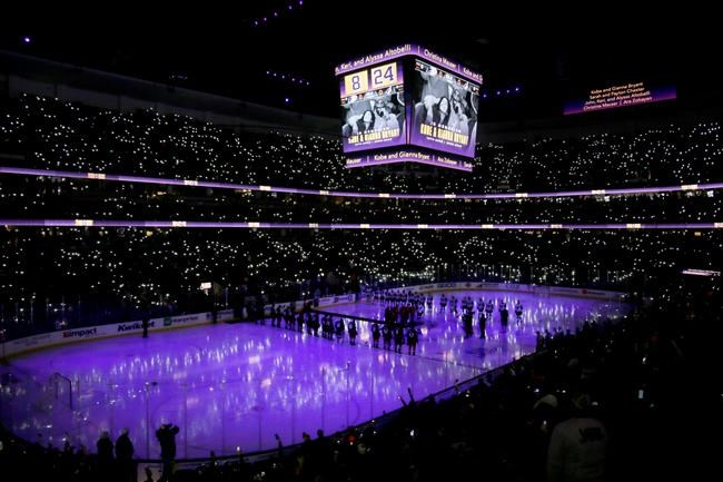 Anaheim Ducks have a moment of silence to acknowledge the passing of former NBA Laker Kobe Bryant, his daughter, Gianna, and seven others in a helicopter crash Sunday before an NHL hockey game against the Arizona Coyotes in Anaheim, Calif., Wednesday, Jan. 29, 2020. (AP Photo/Alex Gallardo)