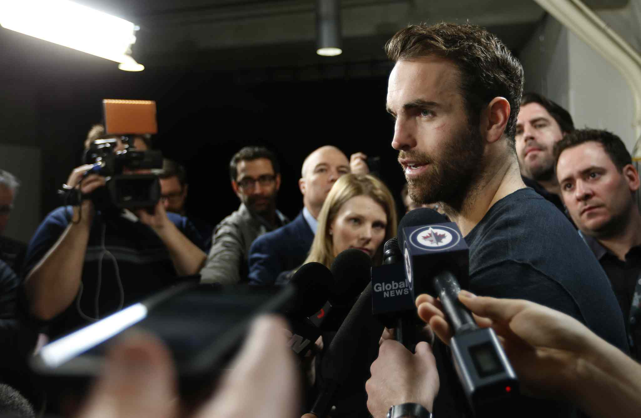 'Does it (his comments) surprise me? No, I think he's an emotional kid. No, I guess it doesn't,' Andrew Ladd said today of Evander Kane's remarks in an article in The Hockey News.