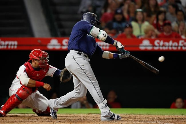 Seattle Mariners' Robinson Cano connects for a three-run double during the eighth inning of a baseball game against the Los Angeles Angels, Saturday, Sept. 15, 2018, in Anaheim, Calif. (AP Photo/Jae C. Hong)