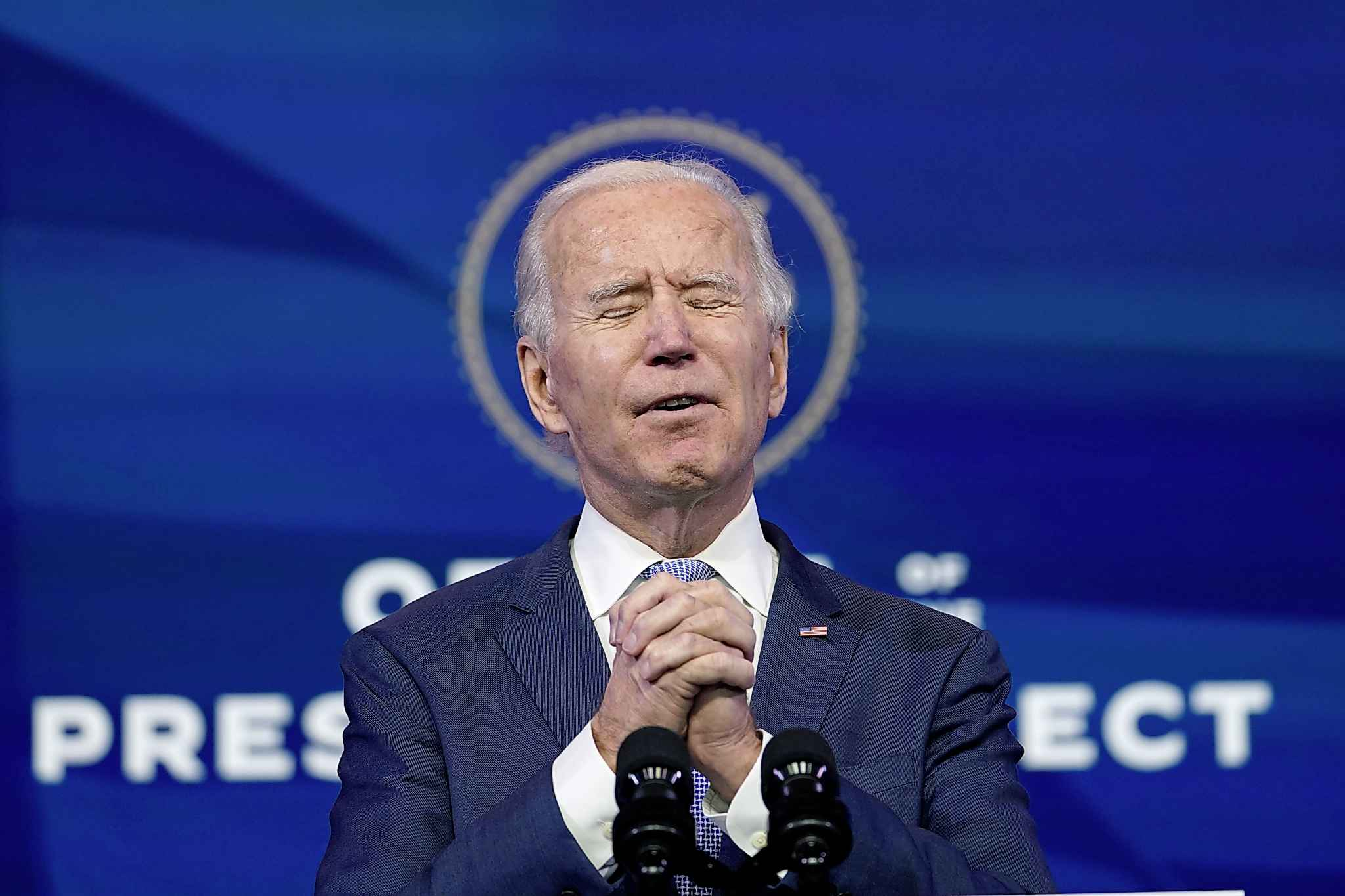 """President-elect Joe Biden speaks at The Queen theater in Wilmington, Del., Wednesday, Jan. 6, 2021. Biden has called the violent protests on the U.S. Capitol """"an assault on the most sacred of American undertakings: the doing of the people's business."""" (AP Photo/Susan Walsh)"""