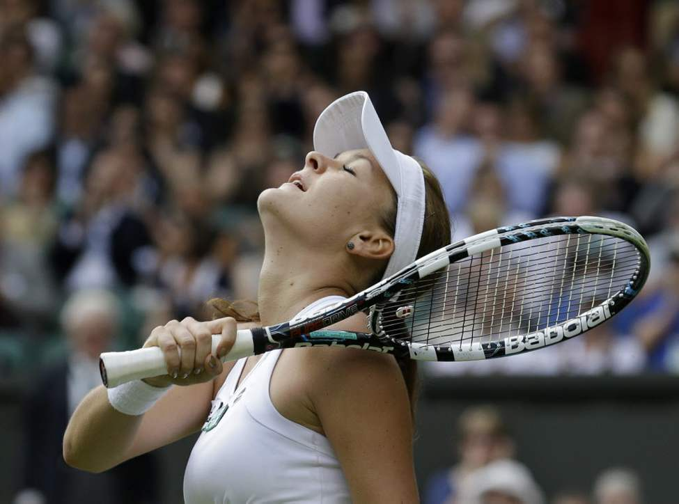 Agnieszka Radwanska of Poland wins a semifinals match against Angelique Kerber of Germany at the All England Lawn Tennis Championships at Wimbledon, England. (AP Photo/Anja Niedringhaus)