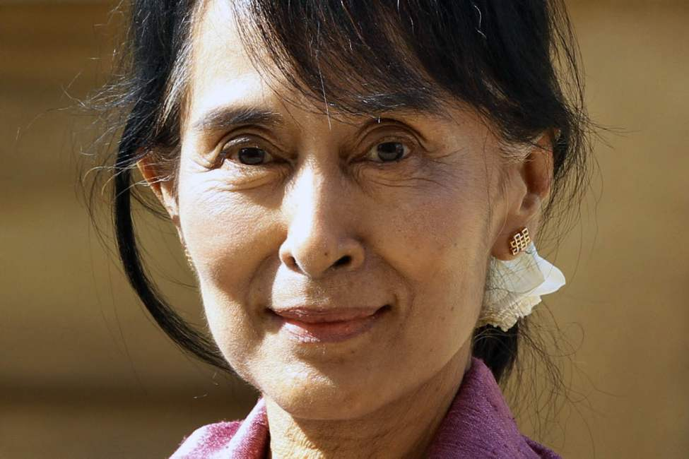 Myanmar opposition leader Aung San Suu Kyi, arrives at Oxford University in Oxford, England. Suu Kyi, who is on her first overseas trip since 1988, has a long association with Britain, where she studied and lived for many years in Oxford with her late husband, Michael Aris, and their two sons, but she has not visited for 24 years. Many of those years were spent under house arrest in Myanmar. On Wednesday, Oxford University will present her with an honorary degree that it awarded in 1993 but that she was not free to collect. (AP Photo/Lefteris Pitarakis)