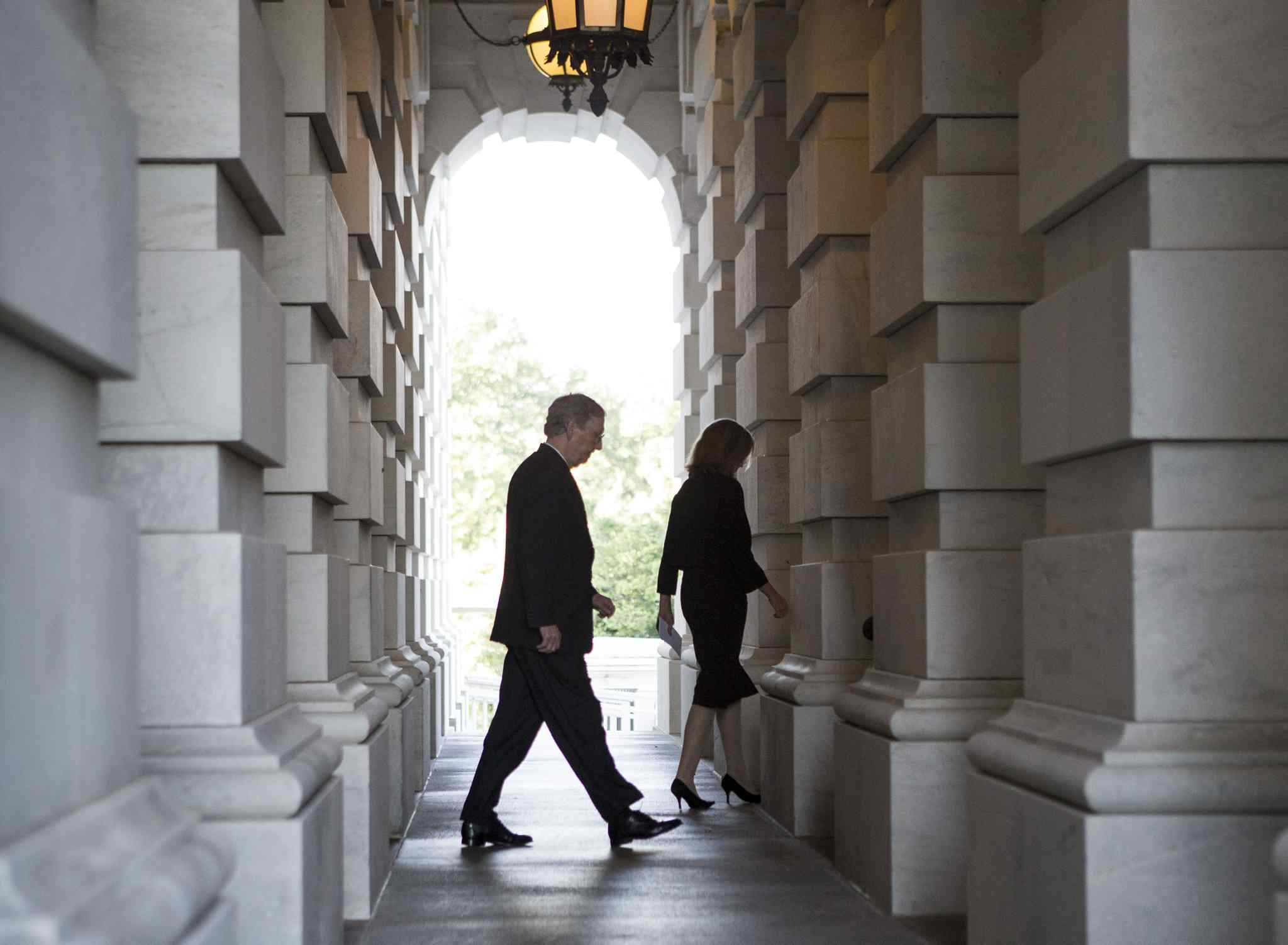 Senate Minority Leader Mitch McConnell, R-Ky., departs the Capitol en route to the White House for an ultimately fruitless meeting with U.S. President Barack Obama.