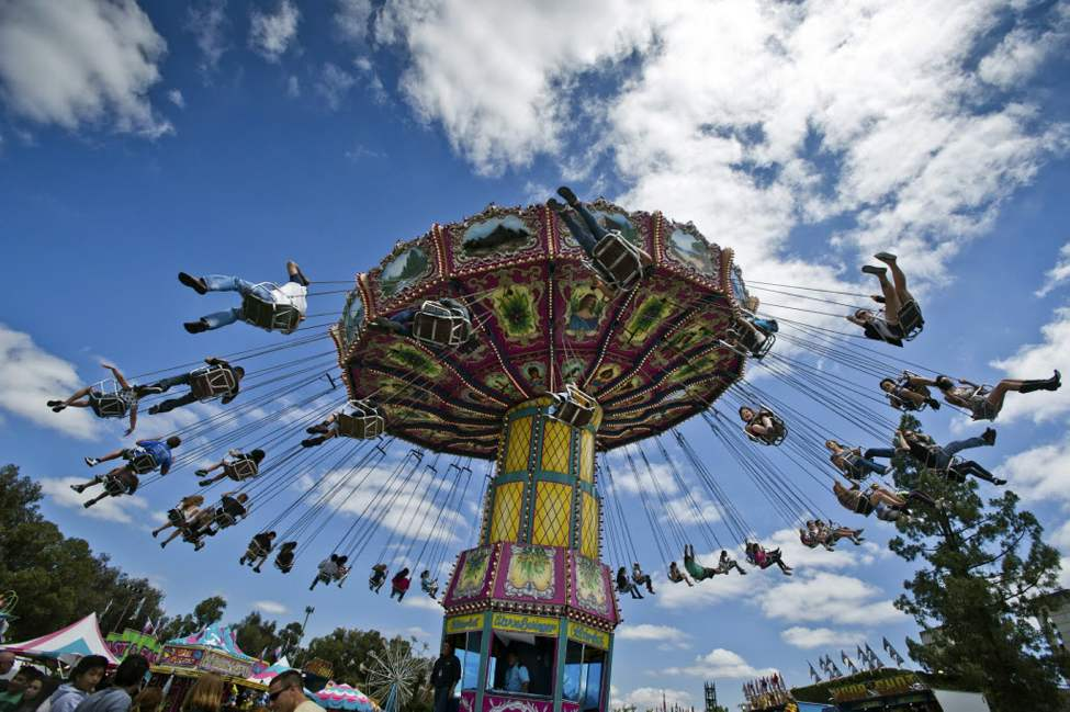 Every seat is filled on the The Wave Swinger ride at the Magical Midway at the California State Fair in Sacramento. (AP Photo/The Sacramento Bee, Manny Crisostomo)