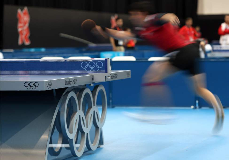 A competitor from Singapore returns a shot during a training session at the ExCel Centre, where the table tennis events will be held at the 2012 Summer Olympics in London. (AP Photo/Sergei Grits)