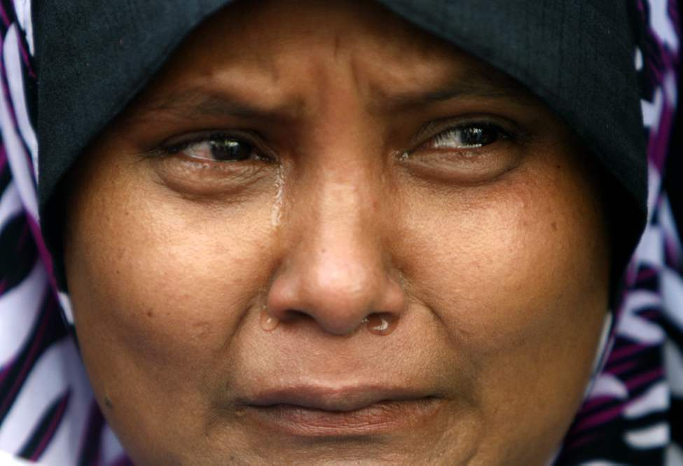 A Rohingya protester cries during a rally to call for an end to the ongoing unrest and violence in Myanmar's Rakhine State, in Kuala Lumpur, Malaysia, Tuesday, June 12, 2012.  (Lai Seng Sin / The Associated Press)