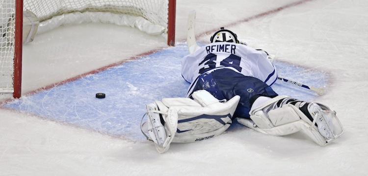 Toronto Maple Leafs goalie James Reimer reacts after the OT winner got past him.