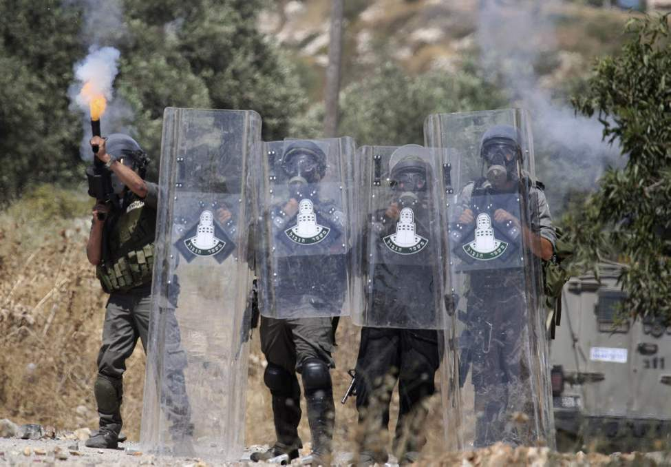 Israeli border police fire teargas towards Palestinian demonstrators during clashes with Palestinians in the northern West Bank village of Kufr Qaddum, near the Jewish settlement of Kdumim. (AP Photo/Nasser Ishtayeh)