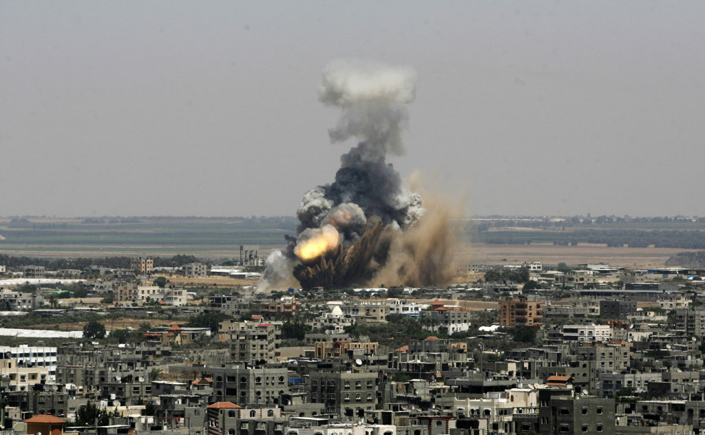 An Israeli missile explodes on impact in Rafah, southern Gaza Strip, on Tuesday, July 8, 2014. The Israeli military launched what could be a long-term offensive against the Hamas-ruled Gaza Strip on Tuesday, striking nearly 100 sites in Gaza and mobilizing troops for a possible ground invasion aimed at stopping a heavy barrage of rocket attacks against Israel.