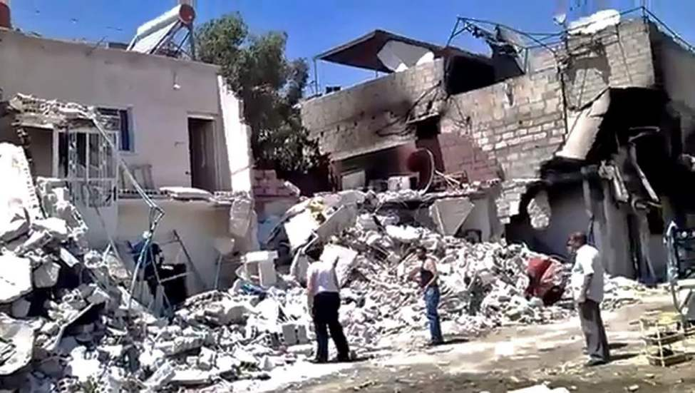 This citizen journalism image provided by Shaam News Network SNN, taken on Monday, purports to show damage from heavy shelling of the al-Qadam district of Damascus, Syria. (AP Photo/Shaam News Network, SNN)
