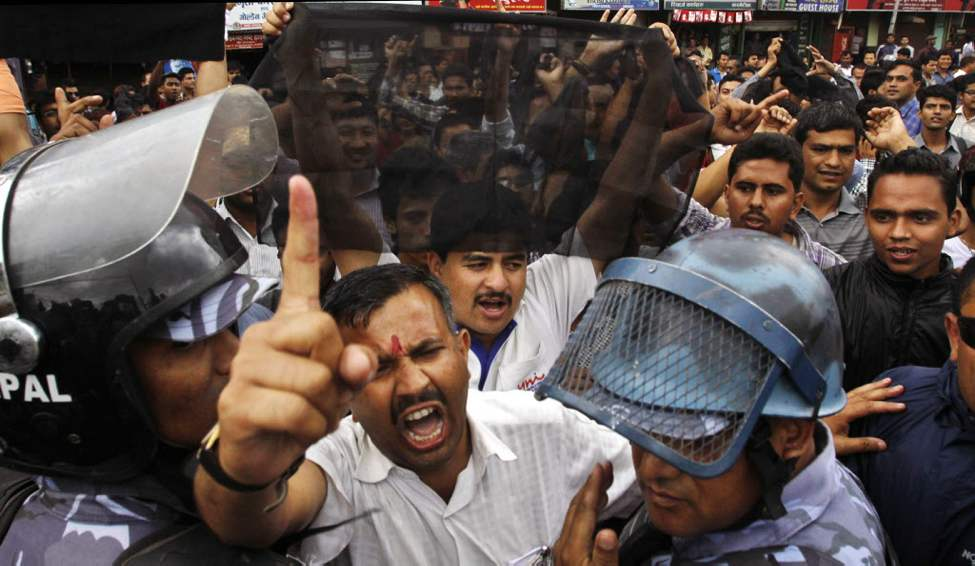 Supporters from the opposition Nepali Congress party shout slogans during a protest in Katmandu. Hundreds of protesters, demanding Prime Minister Baburam Bhattarai's resignation, gathered outside the Tribhuwan International Airport in Katmandu and attempted to block his motorcade. (AP Photo/Binod Joshi)