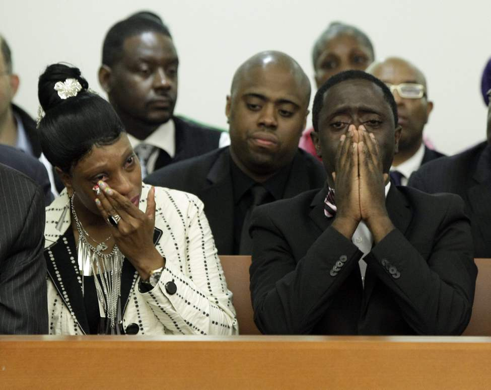 Constance Malcolm and Frank Graham, parents of 18-year-old Ramarley Graham, weep during the arraignment of New York City Police Dept. officer Richard Haste, in Bronx Supreme Court, in New York, Wednesday, June 13, 2012. Police pursued Graham into his Bronx home during a drug investigation last February. He was shot once at close range. (Richard Drew / The Associated Press / Pool)