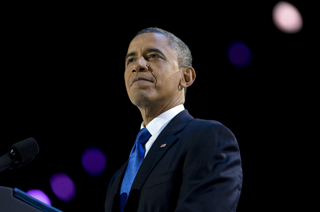 President Barack Obama pauses as he speaks at the election night party at McCormick Place, Wednesday, in Chicago. Obama defeated Republican challenger former Massachusetts Gov. Mitt Romney.  (Carolyn Kaster / The Associated Press)