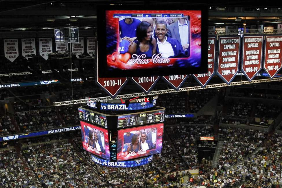 "President Barack Obama and first lady Michelle Obama are seen on the in-house television monitors during the ''Kiss Cam"" segment as they attend the U.S. men's Olympic basketball exhibition game between Team USA and Brazil in Washington. (AP Photo/Pablo Martinez Monsivais)"