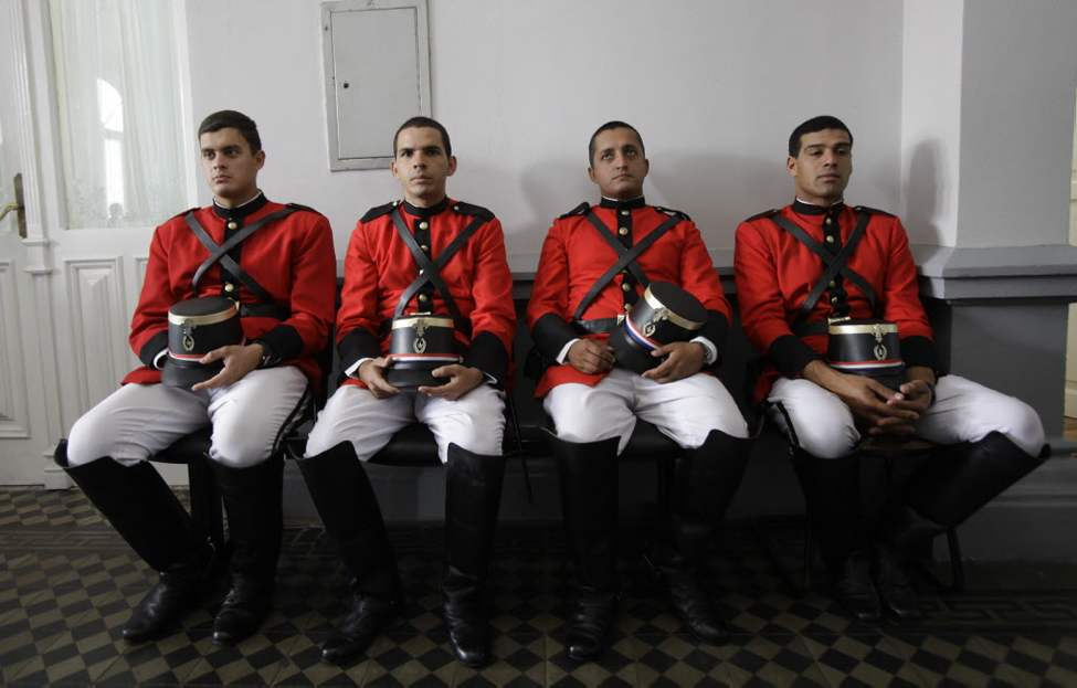 Members of Paraguay's Honor Guard rest after attending to the official oath ceremony for the newly-named cabinet ministers by Paraguay's newly sworn in president, Federico Franco, at the Presidential Palace in Asuncion. Ousted Paraguayan President Fernando Lugo said Monday that he is aiming to return to power, rallying allies at home and abroad to force congress to reverse a landslide vote to remove him that he called a break with democracy. (AP Photo/Jorge Saenz)