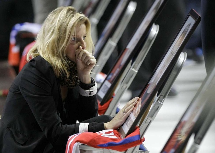 A relative of one of the victims of the plane crash grieves at a memorial service in the Arena Yaroslavl on Saturday, Sept. 10, 2011. (Misha Japaridze / The Associated Press archives)