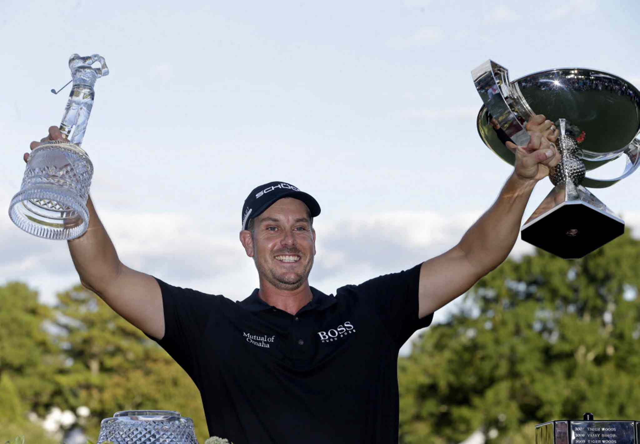 Henrik Stenson has his hands full of hardware Sunday afternoon at East Lake. The Swede won both the Tour Championship and FedEx Cup.