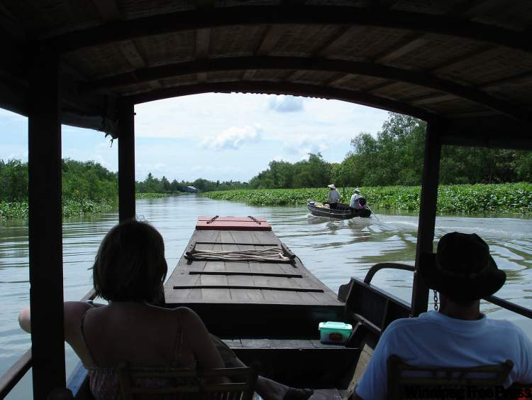 A side tour takes cruise passengers on a sampan ride in the Mekong River Delta in Vietnam.