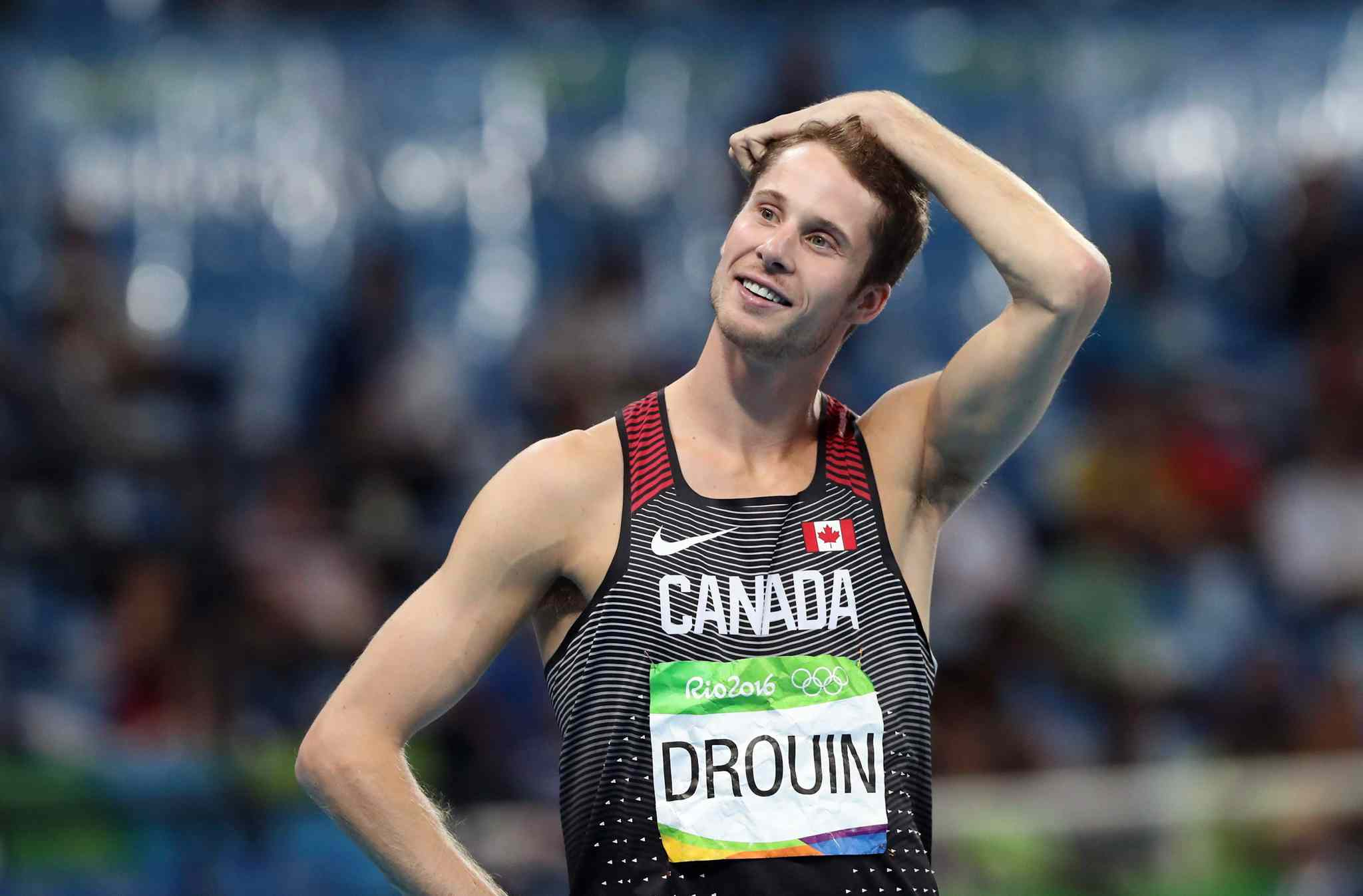 Canada's Derek Drouin competes in the men's high jump final, during the athletics competitions of the 2016 Summer Olympics at the Olympic stadium in Rio de Janeiro, Brazil, Tuesday, Aug. 16, 2016. Canadian high jumper Derek Drouin has withdrawn from the world track and field championships with an Achilles tendon injury.Drouin is the reigning world and Olympic high jump champion. THE CANADIAN PRESS/AP, Lee Jin-man