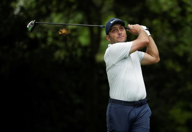 Francesco Molinari, of Italy, hits from the second tee during the final round for the Masters golf tournament Sunday, April 14, 2019, in Augusta, Ga. (AP Photo/Marcio Jose Sanchez)