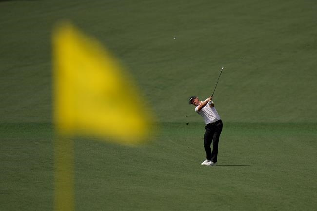 Justin Rose, of England, hits to the second green during the final round of the Masters golf tournament on Sunday, April 11, 2021, in Augusta, Ga. (AP Photo/Matt Slocum)