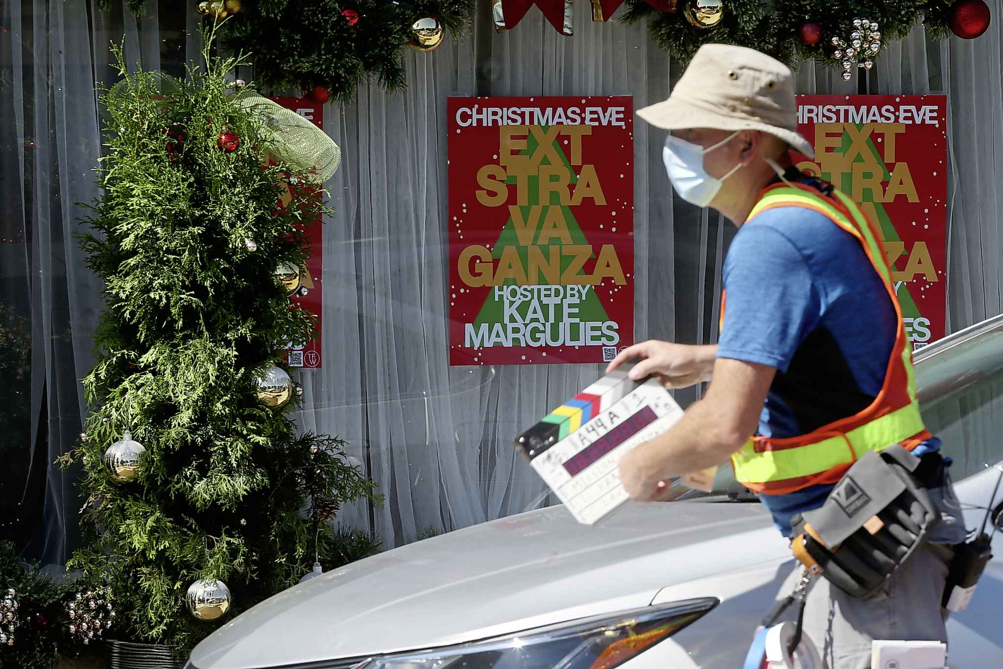SHANNON VANRAES/WINNIPEG FREE PRESS  Christmas signs and decorations hang in shop windows during the film production.