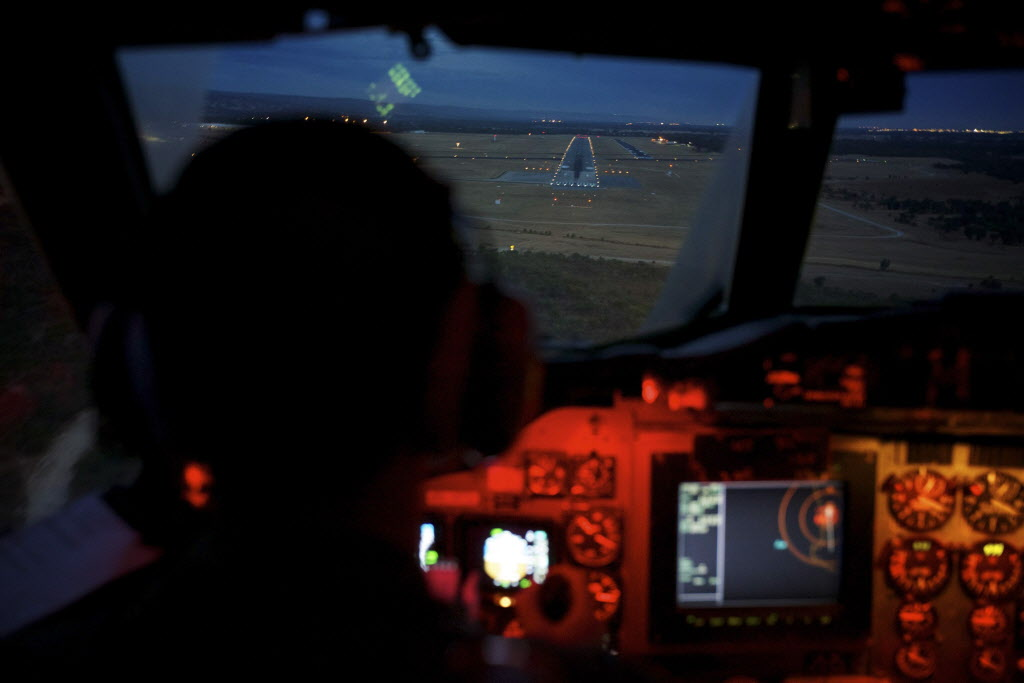 Flying Officer Marc Smith, co-pilot of an RAAF AP-3C Orion makes its final approach to RAAF Base Pearce in Perth, Australia.  (Richard Wainwright / Pool / The Associated Press)