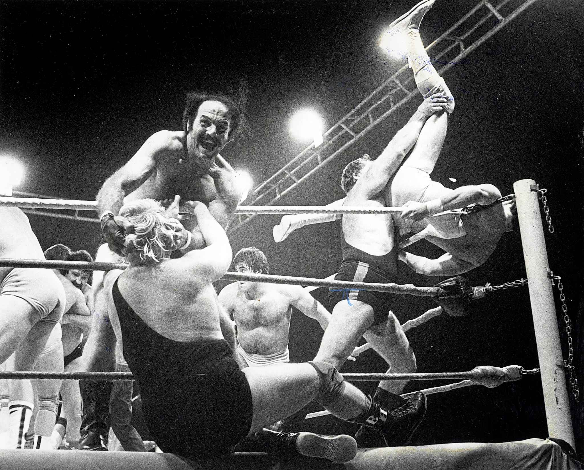KEN GIGLIOTTI / WINNIPEG FREE PRESS FILES  Blackjack Lanza has Bobby 'The Brain' Heenan by the hair as Brad Rheingans throws an opponent over the top rope at a 1983 match at the Winnipeg arena.