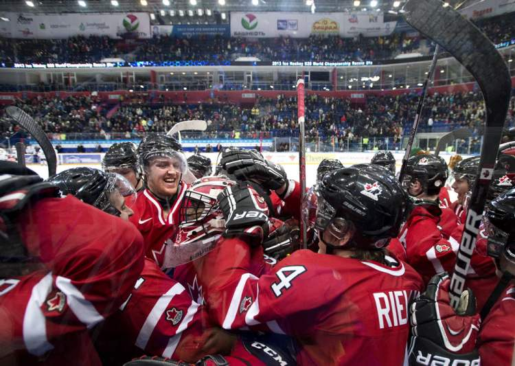 Team Canada players celebrate their victory over the USA Sunday.