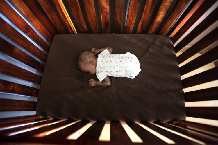 Four-month-old Jonah, who was born with no legs, has an afternoon nap in his crib at Bulrushes, a home for high-risk, abandoned and orphaned babies in Kampala. This photo has been nominated for 2013 National Picture of the Year by the News Photographers Association of Canada in the social issues category.