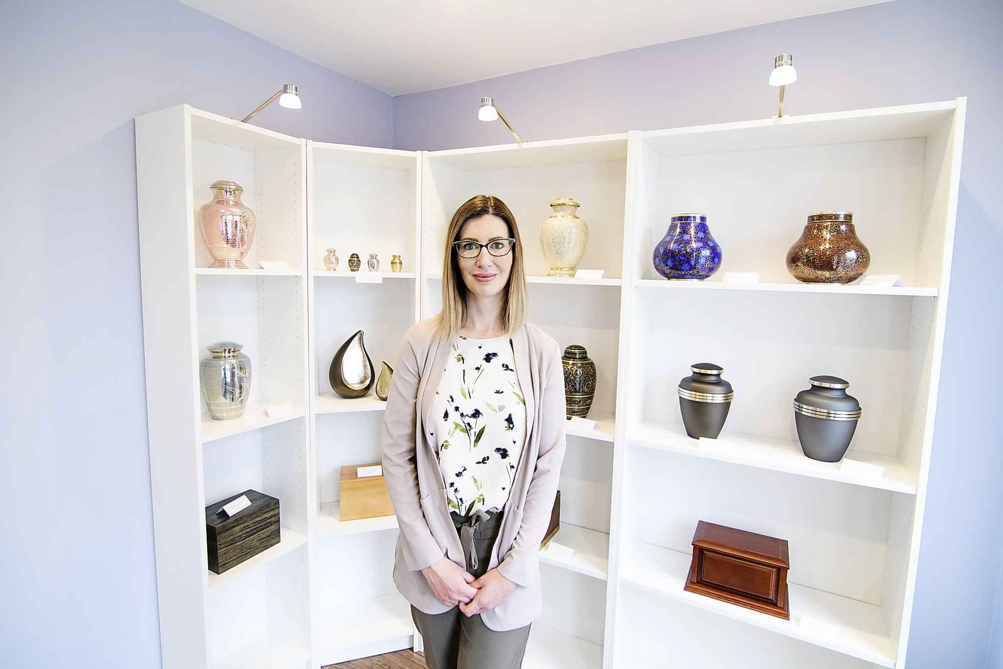 """Mike Sudoma / Winnipeg Free Press</p><p>""""I don't wear a black suit as I did in my previous life as a funeral director,"""" says Ashley Newton, owner of Alterna Cremation, inside her Henderson Highway office.</p>"""
