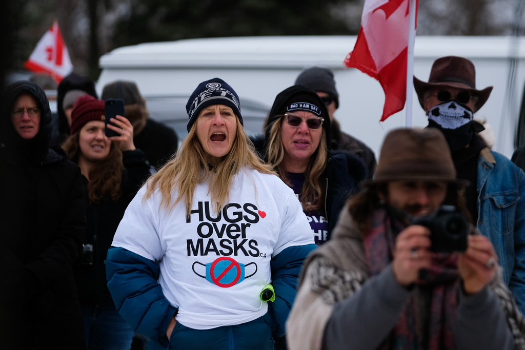 Anti-mask protesters from the Hugs Over Masks group attended a rally in Steinbach last weekend.