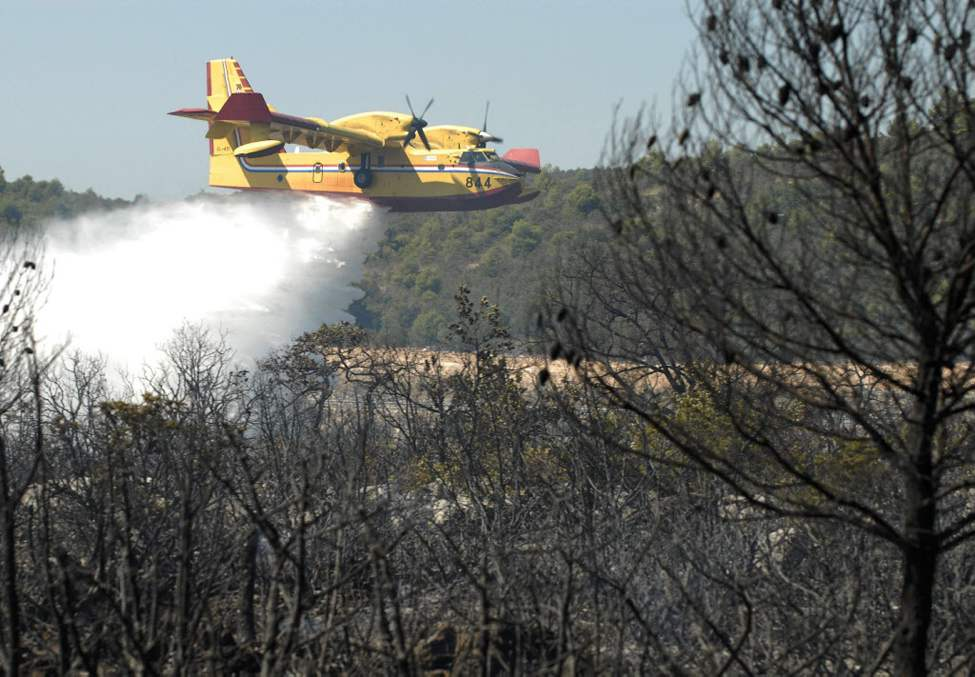 Canadair drops water above a forest fire near the town of Perkovici, south of the Zagreb in Croatia. Croatian firefighters fought a fire on Monday that has destroyed a large swathe of forest and scrub land near the Adriatic coast. (AP Photo/Sulejman Omerbasic)