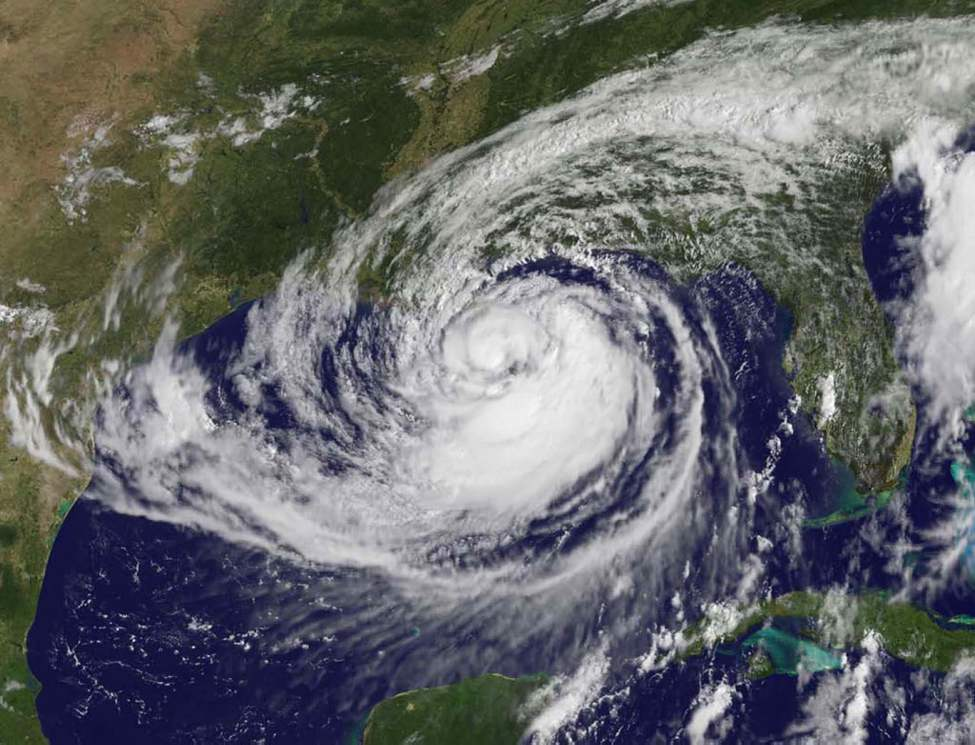 This satellite image provided by NASA and taken Tuesday shows Hurricane Isaac over the Gulf of Mexico, as it approaches New Orleans. The hurricane made landfall Tuesday evening and since then, has pushed water over a rural levee to flood some homes, knocked out power to thousands and has immersed beach-front roads in Louisiana and Mississippi. (AP Photo/NASA)