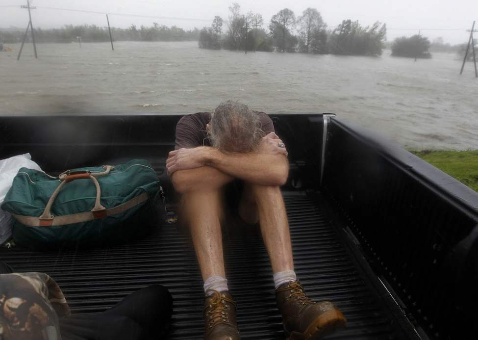 Residents who were rescued from their flooded homes are transported to waiting assistance, after Hurricane Isaac made landfall and flooded homes with 10 feet of water in Braithwaite, La. (AP Photo/Gerald Herbert)