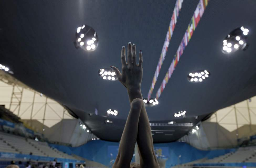 A swimmer warms up in the Aquatic Center during a swimming training session ahead of the 2012 Paralympics in London. (AP Photo/Lefteris Pitarakis)
