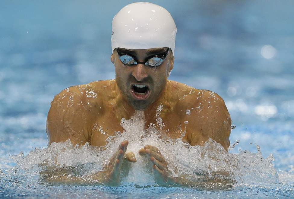 Canada's Benoit Huot competes in the men's 200m Individual Medley SM10 category at the 2012 Paralympics Olympics, in London. (AP Photo/Kirsty Wigglesworth)