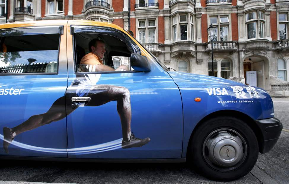 Taxi driver Richard Meid waits for a fare in front of the British Museum during the 2012 Summer Olympics, in London. (AP Photo/Jae C. Hong)