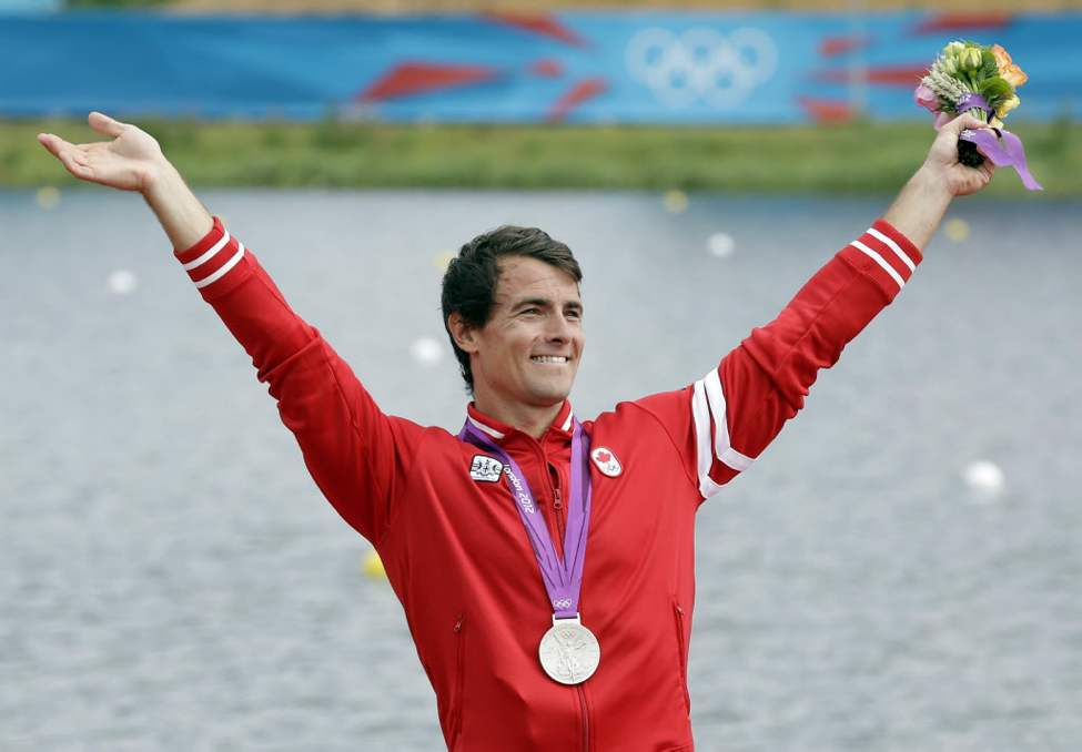 Canada's Adam vav Koeverden celebrates after winning the silver medal in the men's kayak single 1000m at the 2012 Summer Olympics. (AP Photo/Natacha Pisarenko)