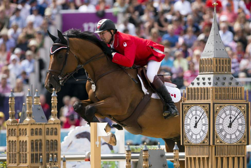 Canada's Ian Millar rides Star Power over a jump in the first round of the Equestrian Individual Jumping final 2012 Summer Olympics. (The Canadian Press / Ryan Remiorz)