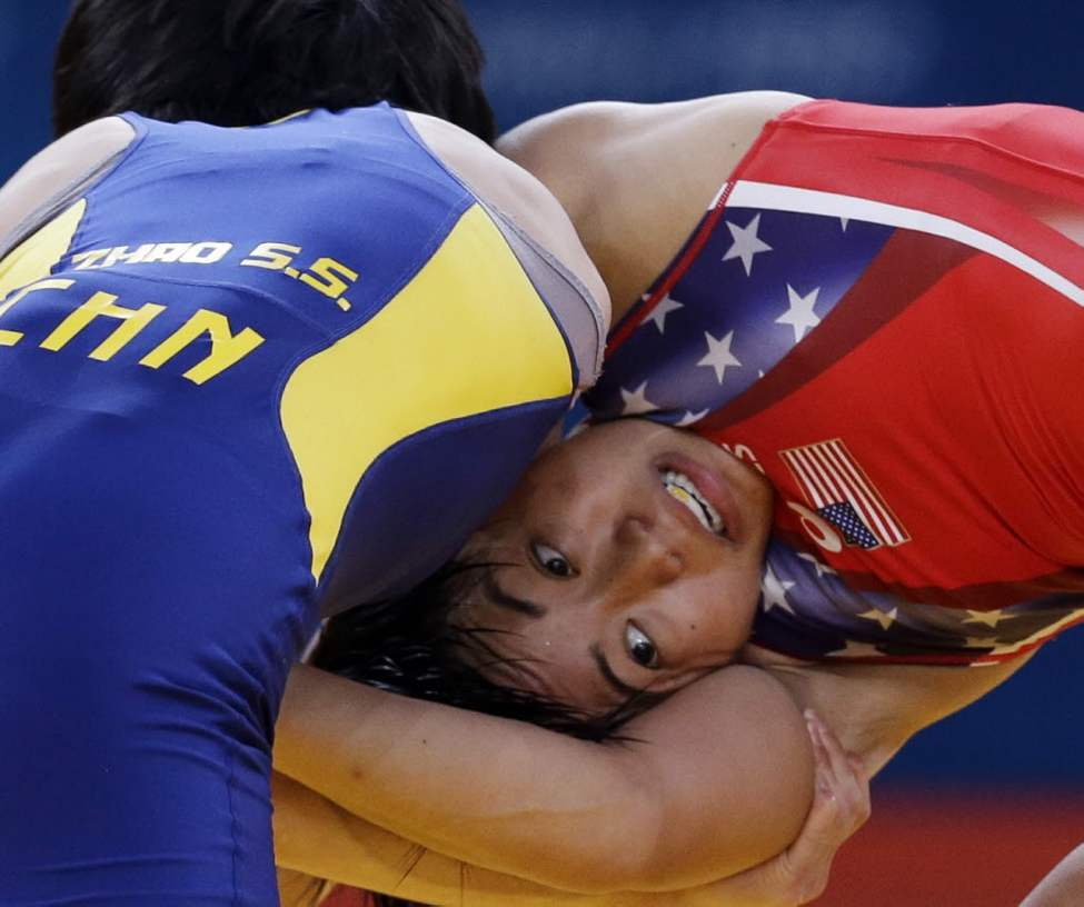 Zhao Shasha of China, left, and Clarissa Kyoko Mei Ling of the United States compete 48-kg women's freestyle wrestling at the 2012 Summer Olympics. (AP Photo/Paul Sancya)