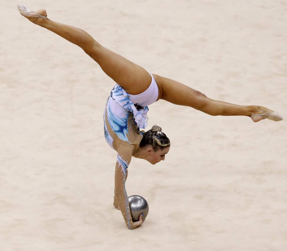 Cyprus' Chrystalleni Trikomiti performs during the rhythmic gymnastics individual all-around qualifications at at the 2012 Summer Olympics. (AP Photo/Julie Jacobson)