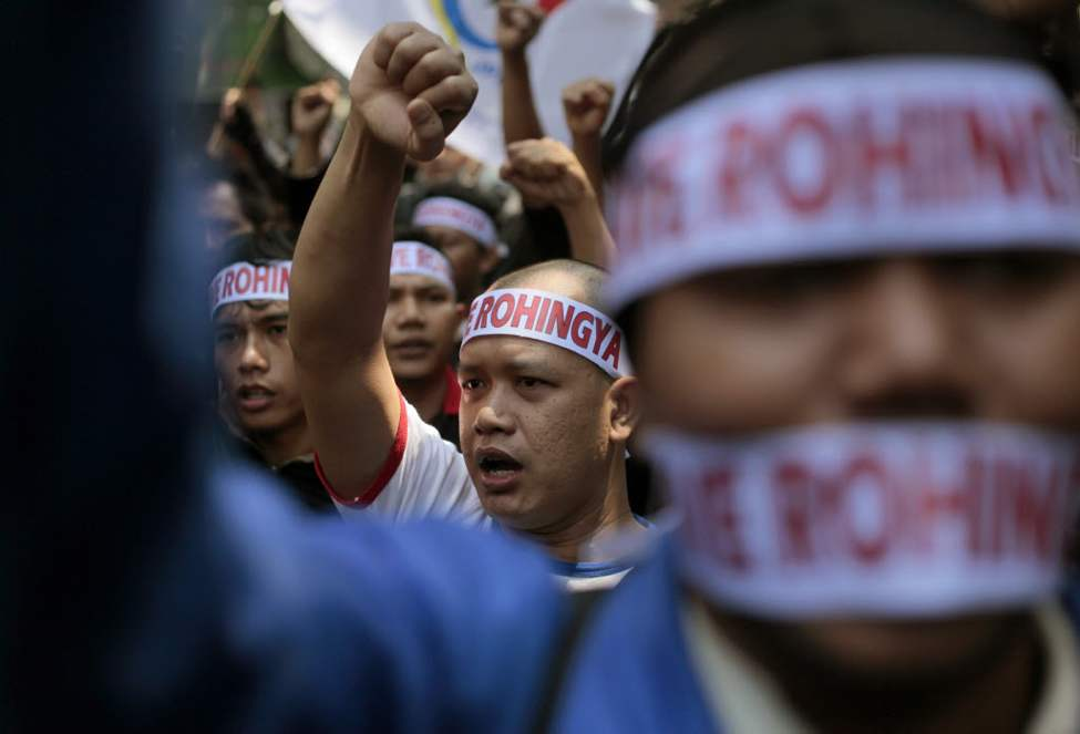 Muslim protesters shout slogans during a rally outside the embassy of Myanmar in Jakarta, Indonesia. Dozens of people staged the rally calling for an end to the violence against ethnic Rohingya Muslims in Rakhine State of Myanmar. (AP Photo/Dita Alangkara)