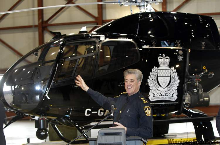 Police Chief Keith McCaskill proudly shows off his department's new airborne crime-fighting tool in December.